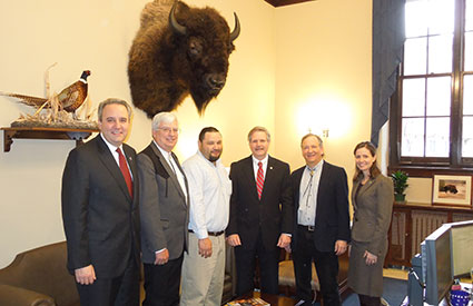 Senator Hoeven (ND) [3rd from right], a cosponsor of legislation to make bison the National Mammal of the United States, met with representatives of the InterTribal Buffalo Council, National Bison Association, and Wildlife Conservation Society. (Feb. 2012) <b>&copy;WCS</b>